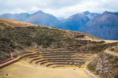 The archaeological site at Moray, travel destination in Cusco region and the Sacred Valley, Peru. Majestic concentric terraces, su Royalty Free Stock Photo