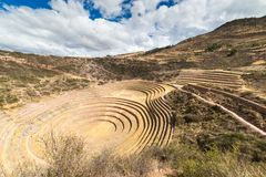 The archaeological site at Moray, travel destination in Cusco region and the Sacred Valley, Peru. Majestic concentric terraces, su Stock Photos