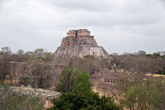 The archaeological site of Uxmal. In Yucatan province, Mexico. In the distance is the 'Sorcerer's Pyramid stock photo