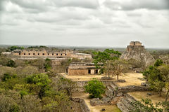 The archaeological site of Uxmal. In Yucatan province, Mexico. In the distance is the 'Sorcerer's Pyramid royalty free stock image