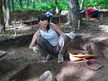 Archaeologist 7. A woman-archaeologist does digging of delubrum of Far East Stock Photo