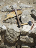 Archaeologist tools on excavation site. Set of archaeologist digging tools on ancient excavation site royalty free stock images