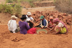 Archaeologist at work. Team of archaeologists sort out pottery after excavation from ancient medieval site Royalty Free Stock Photos
