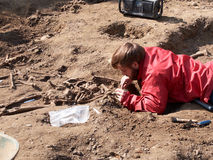 Archaeologists dig up human bones. HALLE, BELGIUM - APRIL 7: Archaeologists dig up human bones several times hundred-year-old, april 7, 2017 Stock Photo