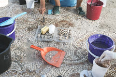 Archaeologists recover artifacts mosaic. Royalty Free Stock Photography