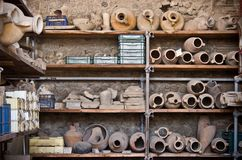 Archaeology background. Shelves with amphoras (archaeology background Royalty Free Stock Images