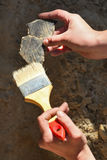 Archaeology: cleaning finds Stock Image