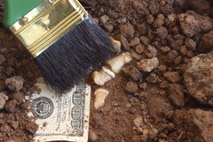 Archaeology and dollar. Royalty Free Stock Photography