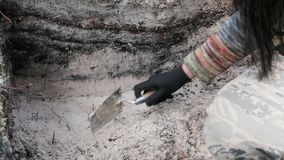 Archaeology - sweep the walls of the excavation. With a trowel stock video