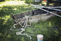 Archaic boat. On the grass field with oars Royalty Free Stock Photos