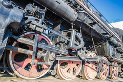 Archaic steam locomotives wheels. Side view of wheels of a old train Royalty Free Stock Photography