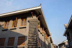 Archaised Chinese traditional building against blue sky in sunny Royalty Free Stock Photography