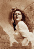 Archangel. Photo based mixed medium image of a powerful female angel striking out over a classical city