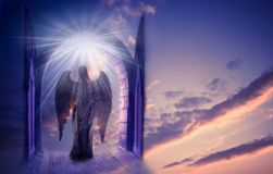 Archangel. A beautiful angel archangel near the opened gate over sky with divine rays of light Royalty Free Stock Photo