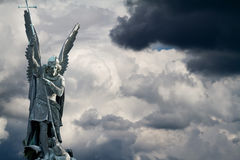 Archangel. Michael fights the dragon stock photography