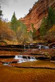 Archangel Cascades during fall in the beautiful Subway slot Canyon at Zion National Park royalty free stock photo