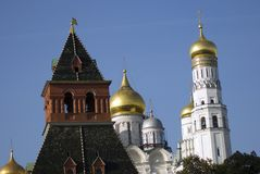 Archangels church and Ivan Great Bell tower of Moscow Kremlin. UNESCO World Heritage Site. Ivan Great Bell tower. Archangels church and Ivan Great Bell tower of Royalty Free Stock Photography