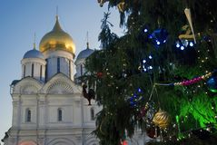 Archangels church of Moscow Kremlin. Color photo. Archangels church of Moscow Kremlin. Christmas and New Year 2018 tree on Sobornaya square. Popular touristic Stock Photos