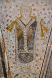 Archbishop holds a crook in his left hand and blesses with his r. Ight. Fresco in Fjelie church, Sweden, Feb 06, 2015 Royalty Free Stock Photo
