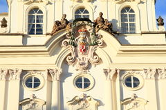 Archbishop`s shield. With statues on Archbishop´s Palace in Prague Czech Republic Royalty Free Stock Image