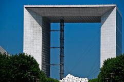 Arche de la Défense Paris. View of the Arche de la Défense from afar, on a bright cloudless summer day in Paris Royalty Free Stock Photography