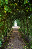 Arched apple tree path. Apple trees arched over a gravel pathway at a formal English Country garden.Shot taken in Autumn 2013 Stock Photos