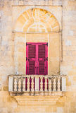 Arched balcony in Mdina. Arched balcony with traditional Maltese colorful door in Mdina Royalty Free Stock Image