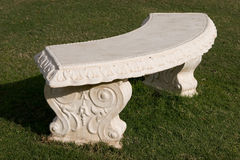Arched bench. Arched stone bench in the lawn Stock Photography