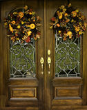 Arched Beveled Front Doors With Fall Wreths Royalty Free Stock Photography