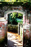 An arched brick entrance. An old arched entryway made of brick Royalty Free Stock Images