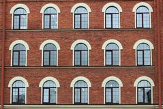 Arched brick house windows royalty free stock image