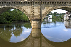 Arched bridge and city view of Argenton-sur-Creuse Royalty Free Stock Photo