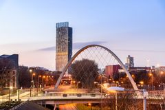 Arched Bridge Manchester UK. The Hulme Arch Bridge and Beetham Tower on a skyline of  Manchester, England Royalty Free Stock Images