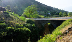 Arched Bridge. Over the dry river bed connect the town of Ribeira Filipe to Campana Riba on the island of Fogo, Cabo Verde Stock Image