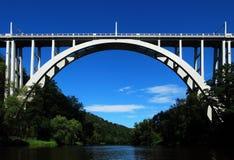 Arched bridge over the river. Concrete arched bridge over the river Royalty Free Stock Images