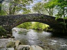 Arched bridge over river Stock Photos