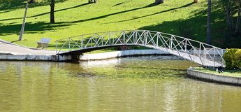 Águas de Lindóia, SP/ Brazil: An arched bridge over the water pond in a park on a sunny day Stock Photo