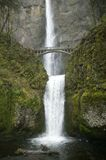 Arched Bridge Over Waterfall Royalty Free Stock Image
