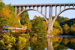 Arched bridge and passenger train Stock Image