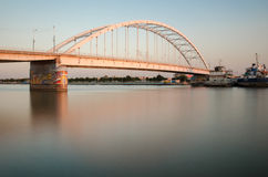 Arched bridge on river. A long exposure of river and spanning bridge Stock Photography