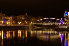 Arched Bridge in Tartu. Bridge and reflection at night in winter Royalty Free Stock Images
