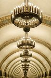 Arched ceiling of the subway interior in Kiev. Interior of the Kiev subway, decorative ceiling, arched arch with large chandeliers, perspective Stock Images
