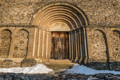 Arched church door. Fortified church door of the oldest Roman basilica and it is located on the top of Saint Michael's Hill in Cisnadioara, Transylvania stock photo