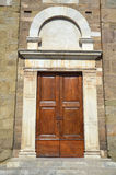 Arched church door in Lucca, Italy Royalty Free Stock Photography