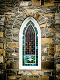 Arched Stained Glass Window in Stone Wall stock photography