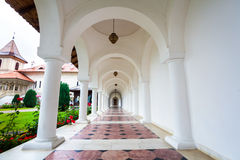 Arched colonade hallway at Sambata de Sus monastery in Transylva royalty free stock images