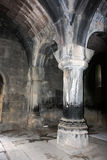 Arched and columned interior of the old Armenian church Vahramas. Old Armenian church from interior with gray walls Royalty Free Stock Image
