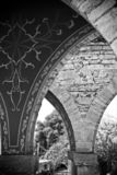 Arched columns in old castle stock photos