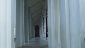 Arched corridor architecture in ancient building design. Long baroque arcade colonnade exterior. Antique design with. Corridor archway perspective stock video footage