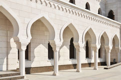 Arched corridor in white mosque Stock Photos